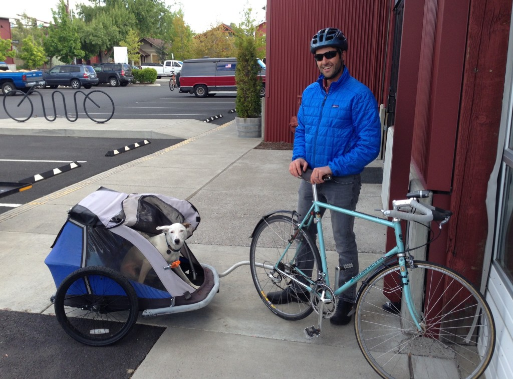 ONDA employee Ben Gordon brings his pup to work by bicycle